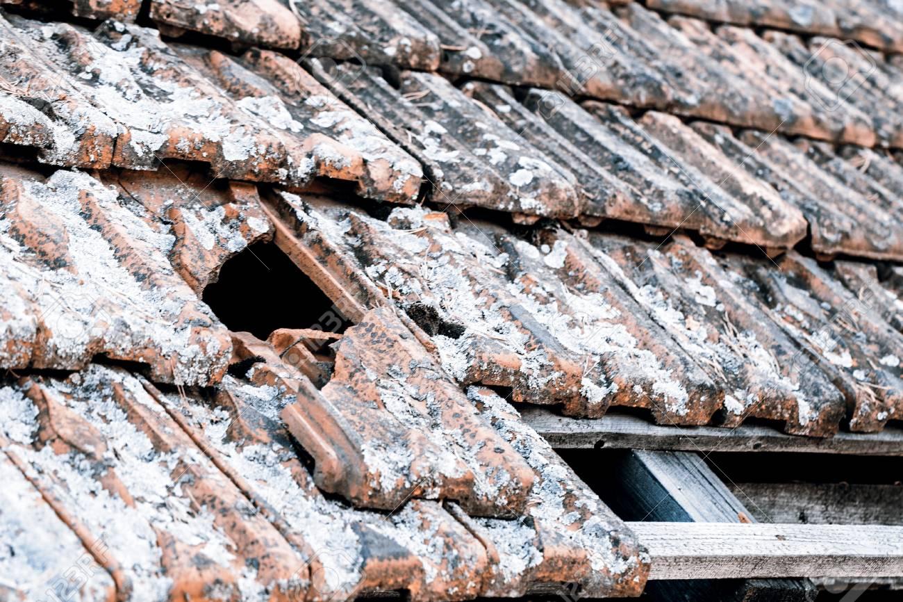 Broken red acient old roof after ages